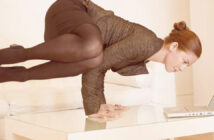 female_office_worker_yoga_on_desk